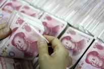 Dólar recua ante rivais e tem alta frente a emergentes, em dia de cautela