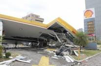 Estabelecimentos comerciais, como um posto de gasolina na Borges, sofreram estragos