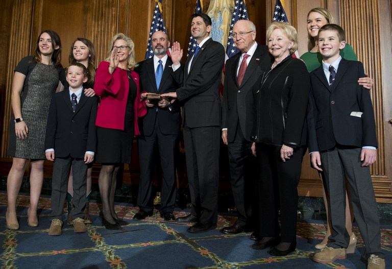 Former US Vice President Dick Cheney (4th R) poses with US Congressman Paul Ryan (C), R-Wisconsin, as his daughter, US Congresswoman Liz Cheney (4th L) is sworn in during the opening of the 115th US Congress on Capitol Hill in Washington, DC, January 3, 2017. / AFP PHOTO / JIM WATSON       Caption