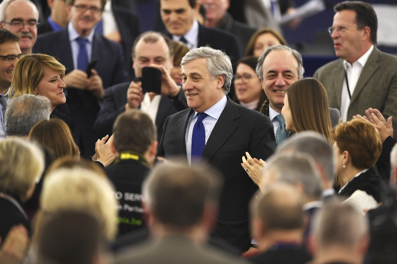 The European Parliament's new President Antonio Tajani (C) is congratulate by members of European Parliament following his election in Strasbourg, eastern France, on January 17, 2017.  / AFP PHOTO / FREDERICK FLORIN       Caption