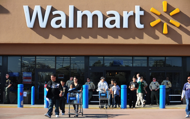 (FILES) This file photo taken on November 23, 2012 shows shoppers at  a Walmart store in Paramount, California.