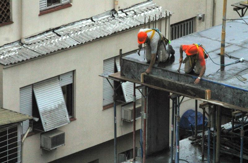 Trabalhadores da Construção Civil.foto Eduardo Seidl.24 06 04