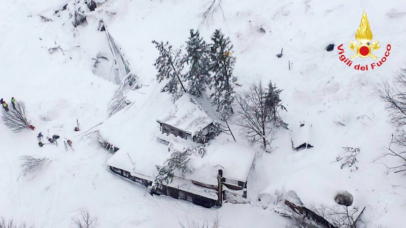 This handout image obtained on the Vigili del Fuoco twitter account on January 19, 2017 shows an aerial view of the Hotel Rigopiano, near the village of Farinfola, on the eastern lower slopes of the Gran Sasso mountain, engulfed by a powerful avalanche.