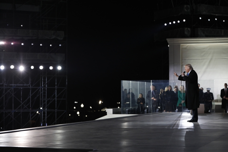 WASHINGTON, DC - JANUARY 19: President-elect Donald Trump speaks during the inauguration concert at the Lincoln Memorial January 19, 2017 in Washington, DC. Hundreds of thousands of people are expected tomorrow for Trump's inauguration as the 45th president of the United States.   Aaron P. Bernstein/Getty Images/AFP       Caption