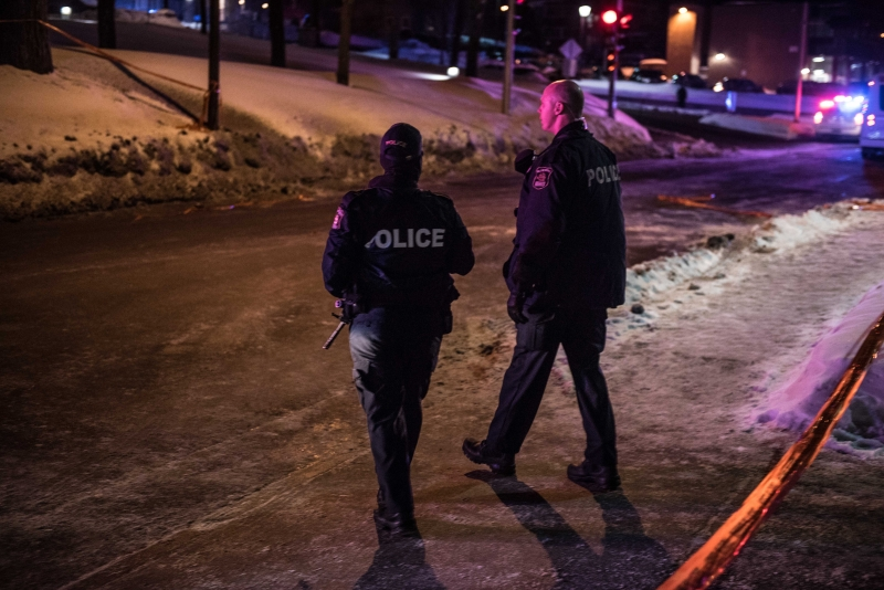 Canadian police officers patrol after a shooting in a mosque at the Québec City Islamic cultural center on Sainte-Foy Street in Quebec city on January 29, 2017.