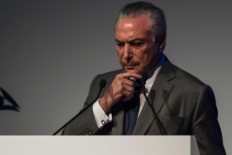Brazilian President Michel Temer gestures during the Latin American Investment Conference in Sao Paulo, Brazil, January 31, 2017 / AFP PHOTO / NELSON ALMEIDA       Caption