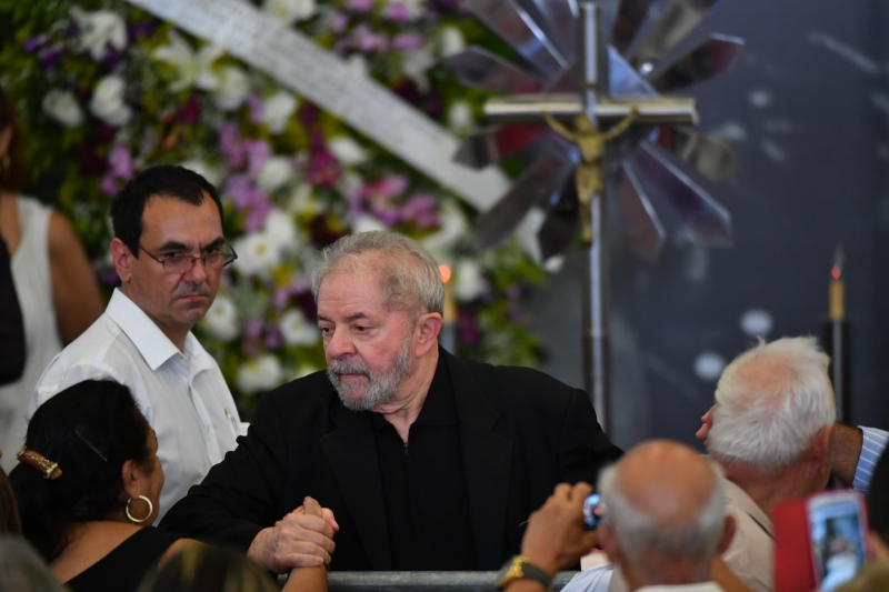 Former Brazilian president Luiz Inacio Lula da Silva greets people during the funeral of his late wife Marisa Leticia, in Sao Bernardo do Campo, a city to the south of Sao Paulo, on February 4, 2017.