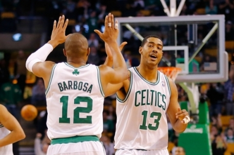 (FILES) This file photo taken on February 7, 2013 shows  Fab Melo #13 of the Boston Celtics being congratulated by teammate Leandro Barbosa #12 after making a basket in the fourth quarter against the Los Angeles Lakers during the game on February 7, 2013 at TD Garden in Boston, Massachusetts.