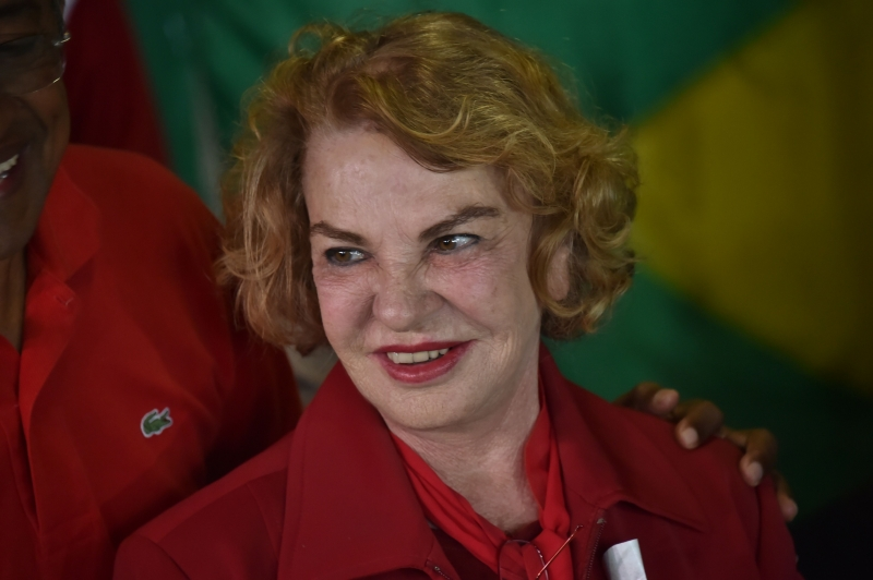 This file photo taken on October 2, 2016 shows the wife of Brazilian former president Luiz Inácio Lula da Silva, Marisa Leticia, at a polling station during the municipal elections' first round in Sao Bernardo do Campo, 25 km south of Sao Paulo, Brazil, on October 2, 2016. Marisa Leticia was declared brain dead on February 2, 2017, doctors in Sao Paulo said. She had been hospitalized since January 24 with a brain haemorrhage due to a ruptured brain aneurism. / AFP PHOTO / NELSON ALMEIDA