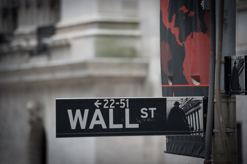 This file photo taken on November 9, 2016 shows the the Wall street sign near the New York Stock Exchange in New York.