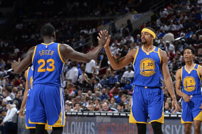 PHILADELPHIA, PA - FEBRUARY 27: Draymond Green #23 and James Michael McAdoo #20 of the Golden State Warriors high-five during a game against the Philadelphia 76ers on February 27, 2017 at the Wells Fargo Center in Philadelphia, Pennsylvania. NOTE TO USER: User expressly acknowledges and agrees that, by downloading and/or using this photograph, user is consenting to the terms and conditions of the Getty Images License Agreement. Mandatory Copyright Notice: Copyright 2017 NBAE   David Dow/NBAE via Getty Images/AFP