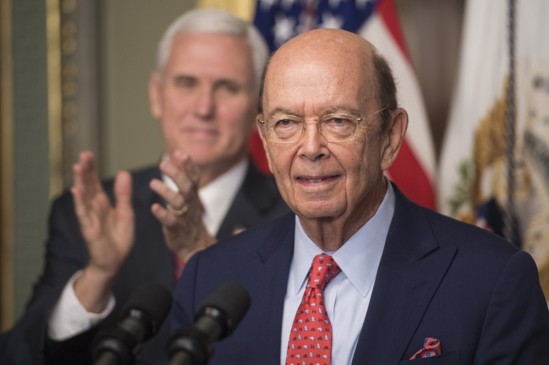 US Secretary of Commerce Willbur Ross (R) speaks after being sworn in by US Vice President Mike Pence (L) in the Old Executive Office Building in Washington, DC, February 28, 2017. / AFP PHOTO / JIM WATSON