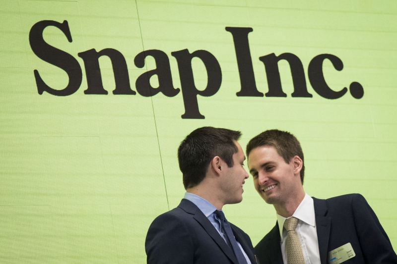 NEW YORK, NY - MARCH 2: (L to ) Snapchat co-founders Bobby Murphy, chief technology officer of Snap Inc., and Evan Spiegel, chief executive officer of Snap Inc., smile at each other after ringing the opening bell at the New York Stock Exchange (NYSE), March 2, 2017 in New York City. Snap Inc. priced its initial public offering at $17 a share on Wednesday and Snap shares will start trading on the New York Stock Exchange (NYSE) on Thursday.