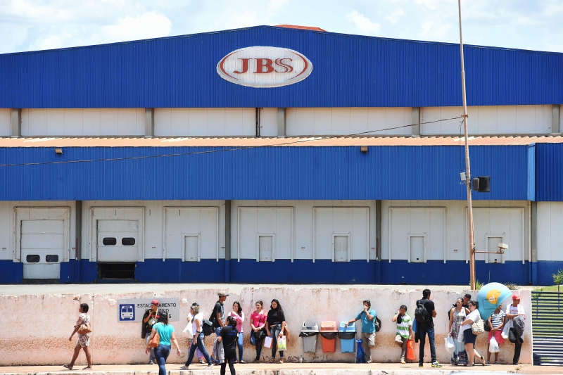 Workers are pictured outside the JBS-Friboi chicken processing plant in Samambaia, Federal District, Brazil on March 17, 2017. 