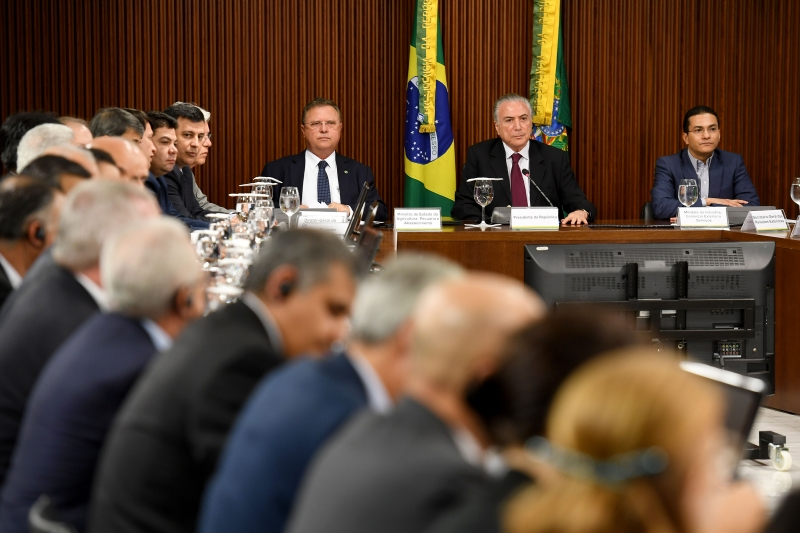 Brazilian President Michel Temer (C), Agriculture Minister Blairo Maggi (L) and Industry and Commerce Minister Marco Pereira (R) meet with ambassadors from countries that import Brazilian meat, at the Planalto Palace in Brasilia on March 19, 2017. 