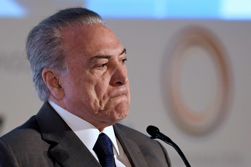 Brazilian President Michel Temer delivers a speech during the opening session of the Conference of Latin American Cities, in Brasilia, on March 21, 2017.