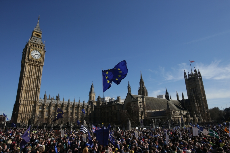 A demonstrator flies an EU flag outside the Houses of Parliament, during a rally following an anti Brexit, pro-European Union (EU) march in London on March 25, 2017, ahead of the British government's planned triggering of Article 50 next week.