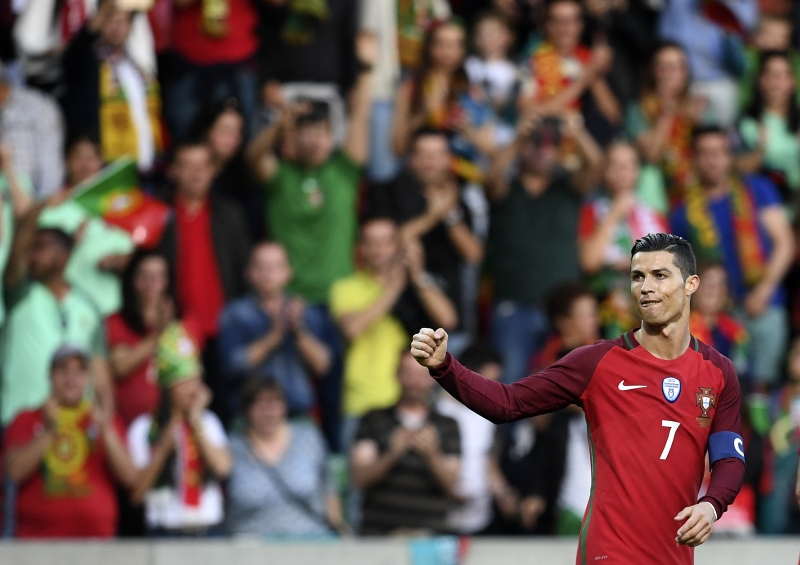 Portugal's forward Cristiano Ronaldo celebrates after scoring during the friendly football match Portugal vs Sweden at the Estadio dos Barreiros in Funchal on March 28, 2017. Portugal x Suécia. Eliminatórias da Copa 2018