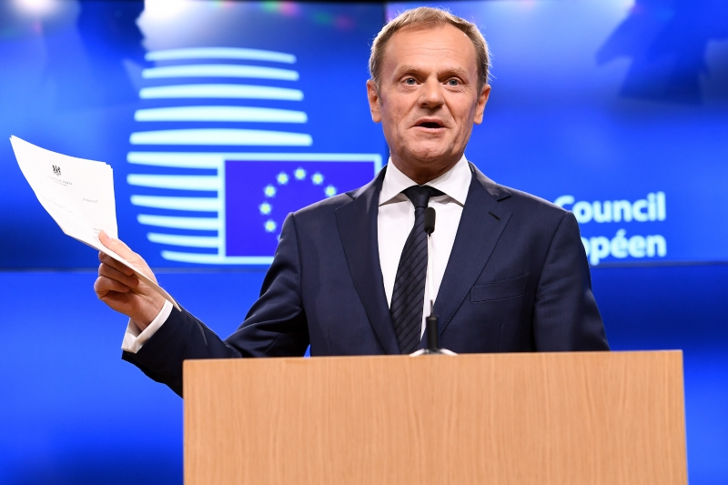 European Council President Donald Tusk holds British Prime Minister Theresa May's formal notice of the UK's intention to leave the bloc under Article 50 of the EU's Lisbon Treaty 