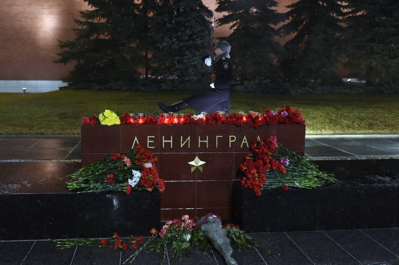 Flowers in memory of victims of the blast in the Saint Petersburg metro are seen at a memorial stone reading Leningrad by the Kremlin wall in central Moscow on April 3, 2017.