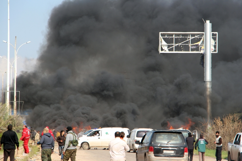 A picture taken on April 15, 2017, shows smoke billowing following a suicide car bombing in Rashidin, west of Aleppo, that targeted buses carrying Syrians evacuated from two besieged government-held towns of Fuaa and Kafraya.
