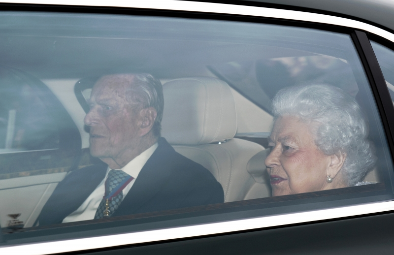 Britain's Queen Elizabeth II and Britain's Prince Philip, Duke of Edinburgh (L) arrive back at Buckingham Palace in London on May 4, 2017, after attending a function.