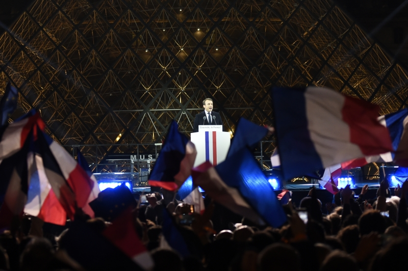 French president-elect Emmanuel Macron delivers a speech in front of the Pyramid at the Louvre Museum in Paris on May 7, 2017, after the second round of the French presidential election. Emmanuel Macron was elected French president on May 7, 2017 in a resounding victory over far-right Front National (FN - National Front) rival after a deeply divisive campaign.