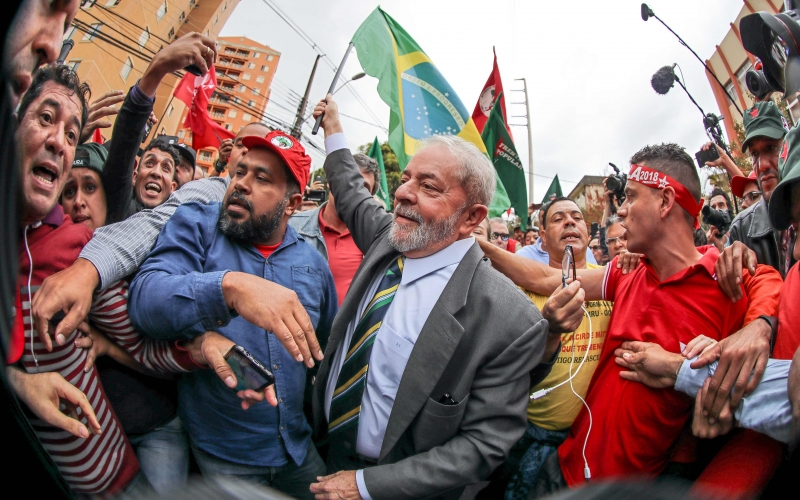A hand out picture released by Instituto Lula shows Brazil's former president (2003-2010) Luiz InÁcio Lula da Silva amid supporters while arrives at a Federal Justice Court in Curitiba, Brazil for a hearing with senior
