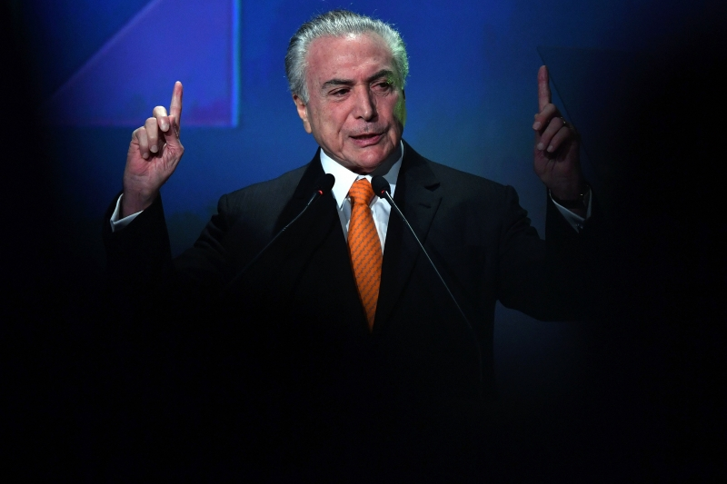Brazilian President Michel Temer speaks during an Investment Forum in Sao Paulo, Brazil on May 30, 2017. / AFP PHOTO / NELSON ALMEIDA