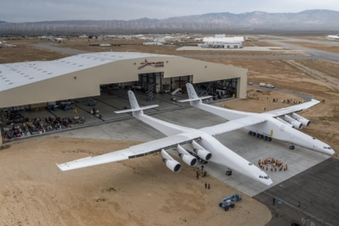 """The Stratolaunch plane is pushed out of the hanger for the first time in the Mojave desert, California on May 31, 2017. A colossal rocket-launching plane touted as the future of space travel is closer to testing, having been rolled out of a hangar in the desert, its creators said. The project backed by billionaire Microsoft co-founder Paul Allen has been proceeding for about six years and was on track for its first launch demonstration as early at 2019, Stratolaunch Systems Corporation chief executive Jean Floyd said in a blog post.  / AFP PHOTO / Stratolaunch Systems Corp / April Keller / RESTRICTED TO EDITORIAL USE - MANDATORY CREDIT """"AFP PHOTO / Stratolaunch Systems Corp/ April Keller"""" - NO MARKETING NO ADVERTISING CAMPAIGNS - DISTRIBUTED AS A SERVICE TO CLIENTS"""