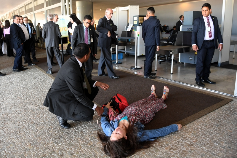 An unidentified woman who was stopped while trying to get inside the Planalto Palace shouting