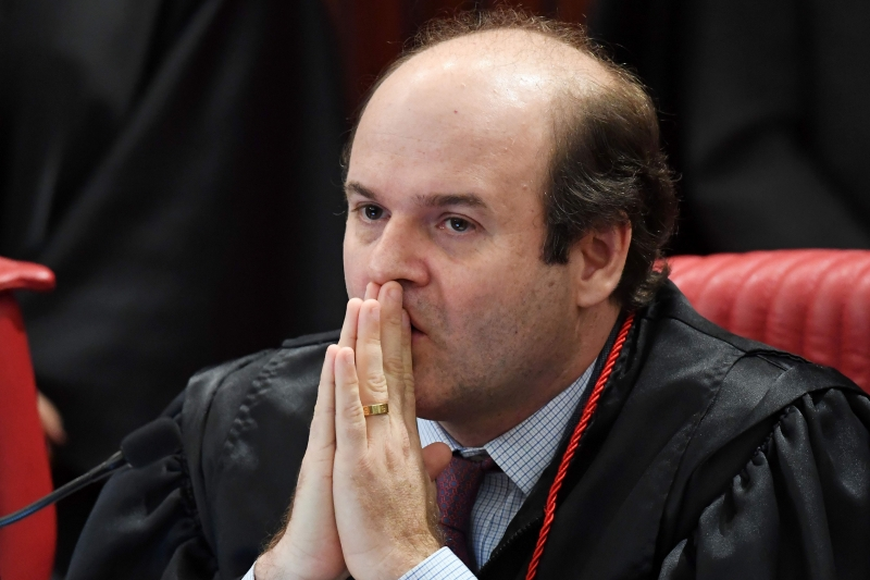 Supreme Electoral Court (TSE) Judge Tarcísio Neto gestures during the session examining whether the 2014 reelection of president Dilma Rousseff and her then vice president Michel Temer should be invalidated because of corrupt campaign funding, in Brasilia, on June 9, 2017. 