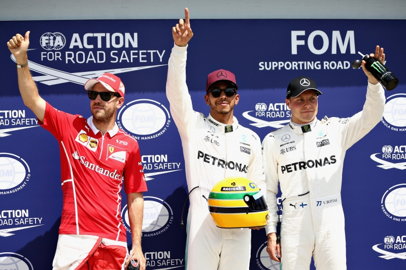 MONTREAL, QC - JUNE 10: Pole sitter Lewis Hamilton of Great Britain and Mercedes GP with second placed qualifier Sebastian Vettel of Germany and Ferrari and third placed qualifier Valtteri Bottas of Finland and Mercedes GP in parc ferme during qualifying for the Canadian Formula One Grand Prix at Circuit Gilles Villeneuve on June 10, 2017 in Montreal, Canada.   Will Taylor-Medhurst/Getty Images/AFP       Caption