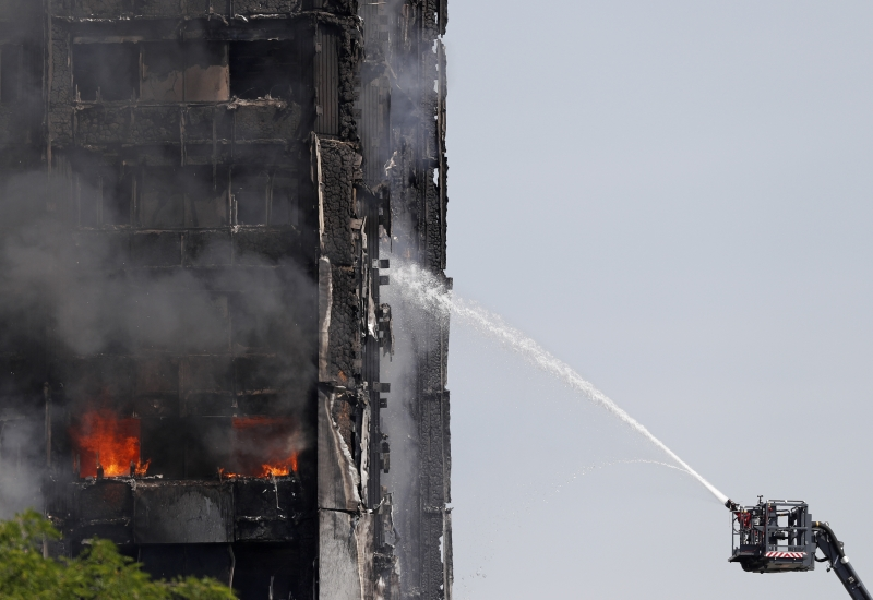 Smoke billows from Grenfell Tower as firefighters attempt to control a blaze at a residential block of flats on June 14, 2017 in west London.