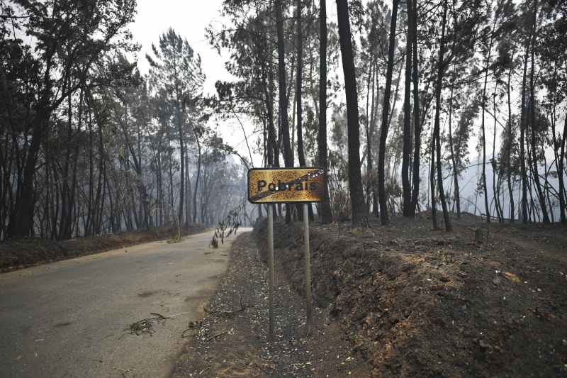 Picture shows a traffic sign showing the name of Pobrais, one of the villages with higher number of victims, in Pobrais, Pedrogao Grande on June 19, 2017. 