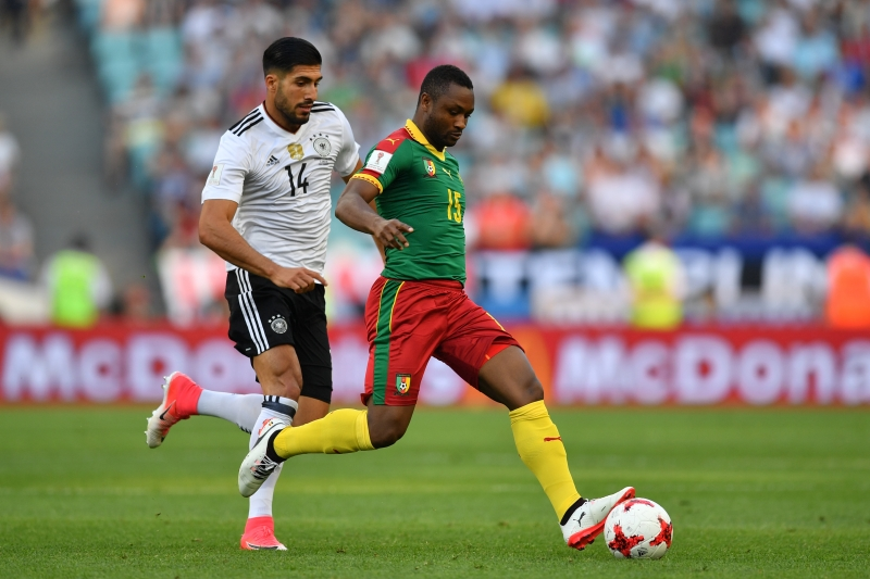 Cameroon's midfielder Sebastien Siani (R) challenges Germany's midfielder Emre Can during the 2017 FIFA Confederations Cup group B football match between Germany and Cameroon at the Fisht Stadium Stadium in Sochi on June 25, 2017. / AFP PHOTO / Yuri CORTEZ