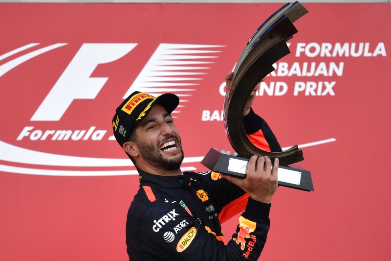 Winner Red Bull's Australian driver Daniel Ricciardo celebrates with the trophy after the Formula One Azerbaijan Grand Prix at the Baku City Circuit in Baku on June 25, 2017. / AFP PHOTO / Andrej ISAKOVIC