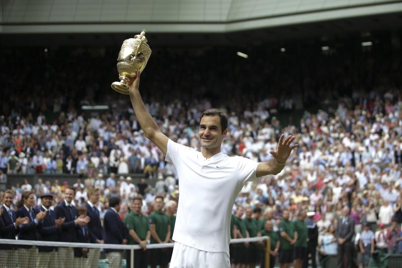 Federer se torna o maior vencedor no tradicional piso de gramado inglês