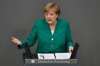 Antes da cúpula da UE, Merkel defende registro de imigrantes e solução europeia