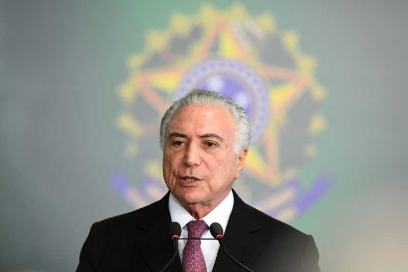 Brazilian President Michel Temer delivers a speech during the inauguration ceremony of his new Labour Minister Caio Vieira de Mello at the Planalto Palace in Brasilia on July 10, 2018.  Vieira de Melo replaces Helton Yomura, who resigned after being accused of corruption. / AFP PHOTO / EVARISTO SA       Caption