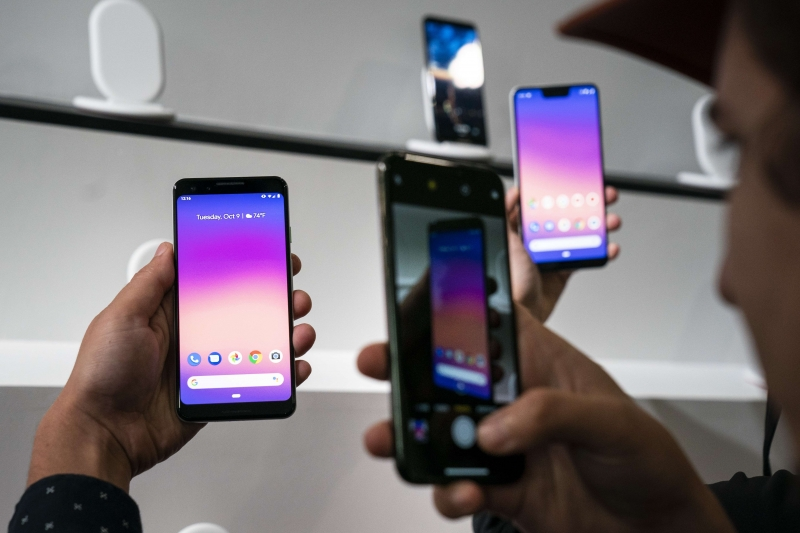 NEW YORK, NY - OCTOBER 9: A guest takes pictures of the new Google Pixel 3 smartphone during a Google product release event, October 9, 2018 in New York City. The phones will go on sale on October 18 for a base starting retail price of $799 for the Pixel 3 and $899 for the Pixel 3 XL. Google also released a new tablet called the Pixel Slate and the Google Home Hub.   Drew Angerer/Getty Images/AFP