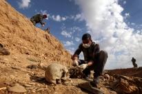Estado Islâmico enterrou 12 mil cadáveres em  valas comuns