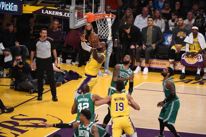 LOS ANGELES, CA - MARCH 9: LeBron James #23 of the Los Angeles Lakers shoots the ball against the Boston Celtics on March 9, 2019 at STAPLES Center in Los Angeles, California. NOTE TO USER: User expressly acknowledges and agrees that, by downloading and/or using this Photograph, user is consenting to the terms and conditions of the Getty Images License Agreement. Mandatory Copyright Notice: Copyright 2019 NBAE   Adam PantozziNBAE via Getty Images/AFP       Caption