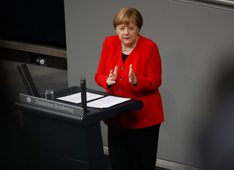 German Chancellor Angela Merkel gesures as she addresses delegates during a session at the Bundestag (lower house of parliament) on March 21, 2019 in Berlin, ahead of a EU summit largely devoted to Brexit. (Photo by Odd ANDERSEN / AFP)