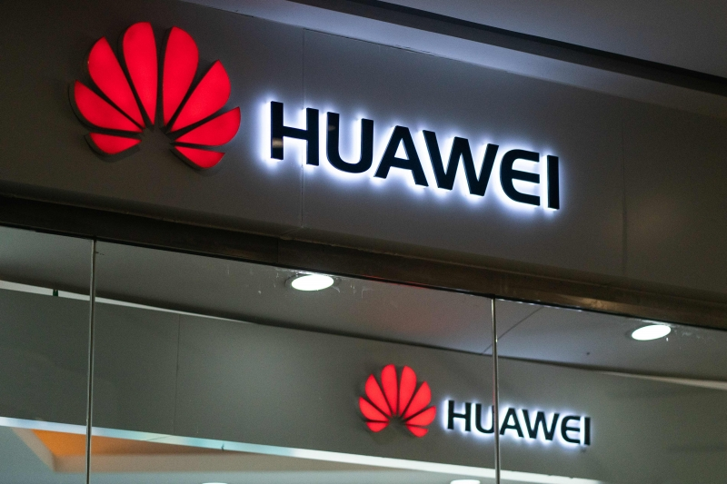 A Huawei logo is displayed at a retail store in Beijing on May 23, 2019. - Chinese telecom giant Huawei says it could roll out its own operating system for smartphones and laptops in China by the autumn after the United States blacklisted the company, a report said on May 23. (Photo by FRED DUFOUR / AFP)       Caption