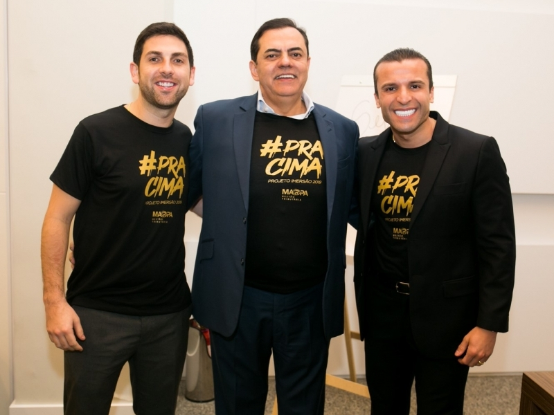 Eduardo Bitello, Marcos Tolentino e Michael Soares no evento do Grupo Marca