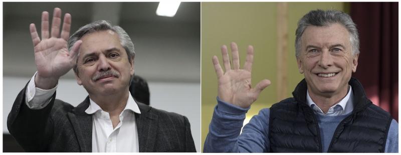 Candidato da oposição à presidência, Alberto Fernández (e), venceu Mauricio Macri em eleições primárias