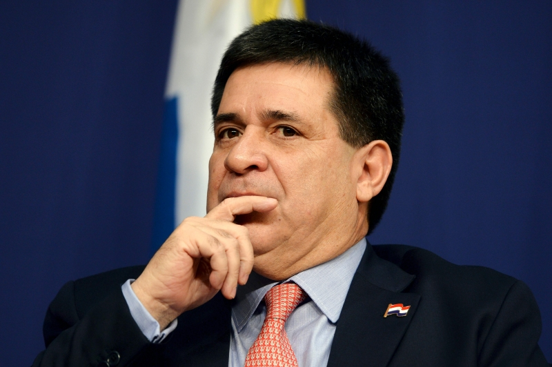 (FILES) In this file photo taken on June 03, 2016, Paraguay's President Horacio Cartes listens during the Latin America and Caribbean International economic forum at the Economy Ministry in Paris. - Brazilian justice called on November 19, 2019, for Paraguay's former President Horacio Cartes to be placed under preventive detention for alleged money laundering in conection with the Lava Jato anti-corruption probe, official sources and the state-run Agencia Brasil reported. (Photo by ERIC PIERMONT / AFP)