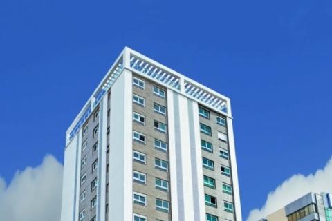 Edifício vizinho aumenta capacidade de hotel