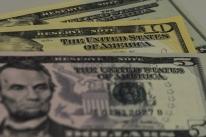 Bolsas de NY fecham em queda com impasse fiscal nos EUA e balanços corporativos
